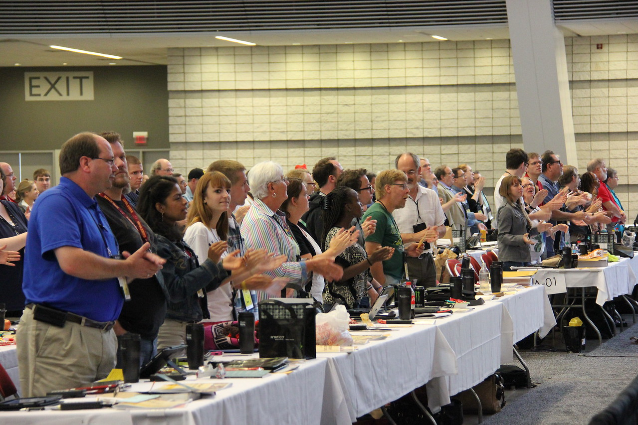 Voting members react to the global church presentation.