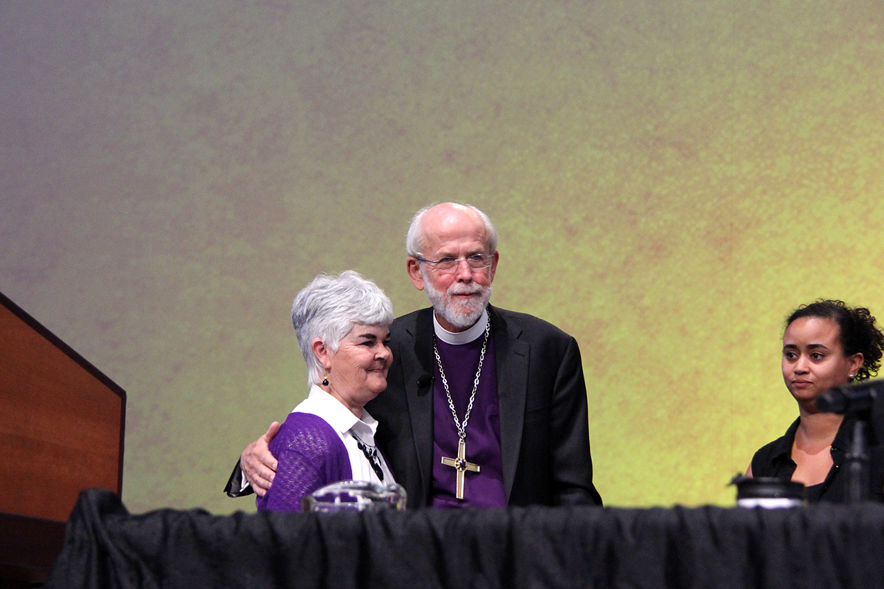 Presiding Bishop Mark S. Hanson and his wife, Mrs. Ione Hanson, listen to the applause and appreciation of the Assembly while their daughter looks on.