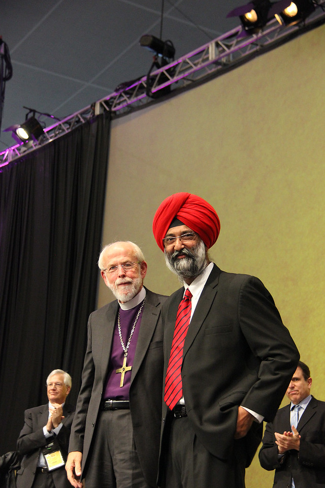 Presiding Bishop Mark S. Hanson and Dr. Tarunjit Singh Butalia are on stage during the Assembly.