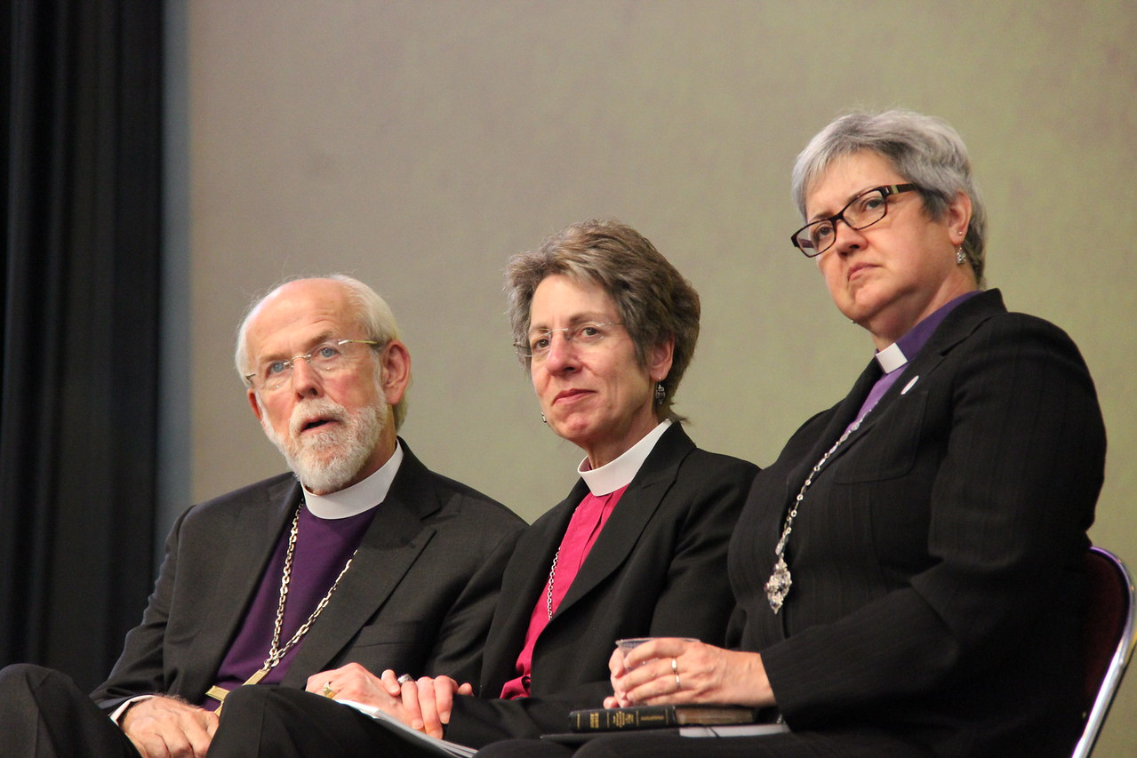 Presiding Bishop Mark S. Hanson, the Most Reverend Katharine Jefferts Schori, presiding bishop of The Episcopal Church and Bishop Susan Johnson, the national bishop of the Evangelical Lutheran Church in Canada and the Lutheran World Federation Vice-President for North America, listen to The Rev. Dr. Olav Fykse Tveit, general secretary of the World Council of Churches greet the Assembly.