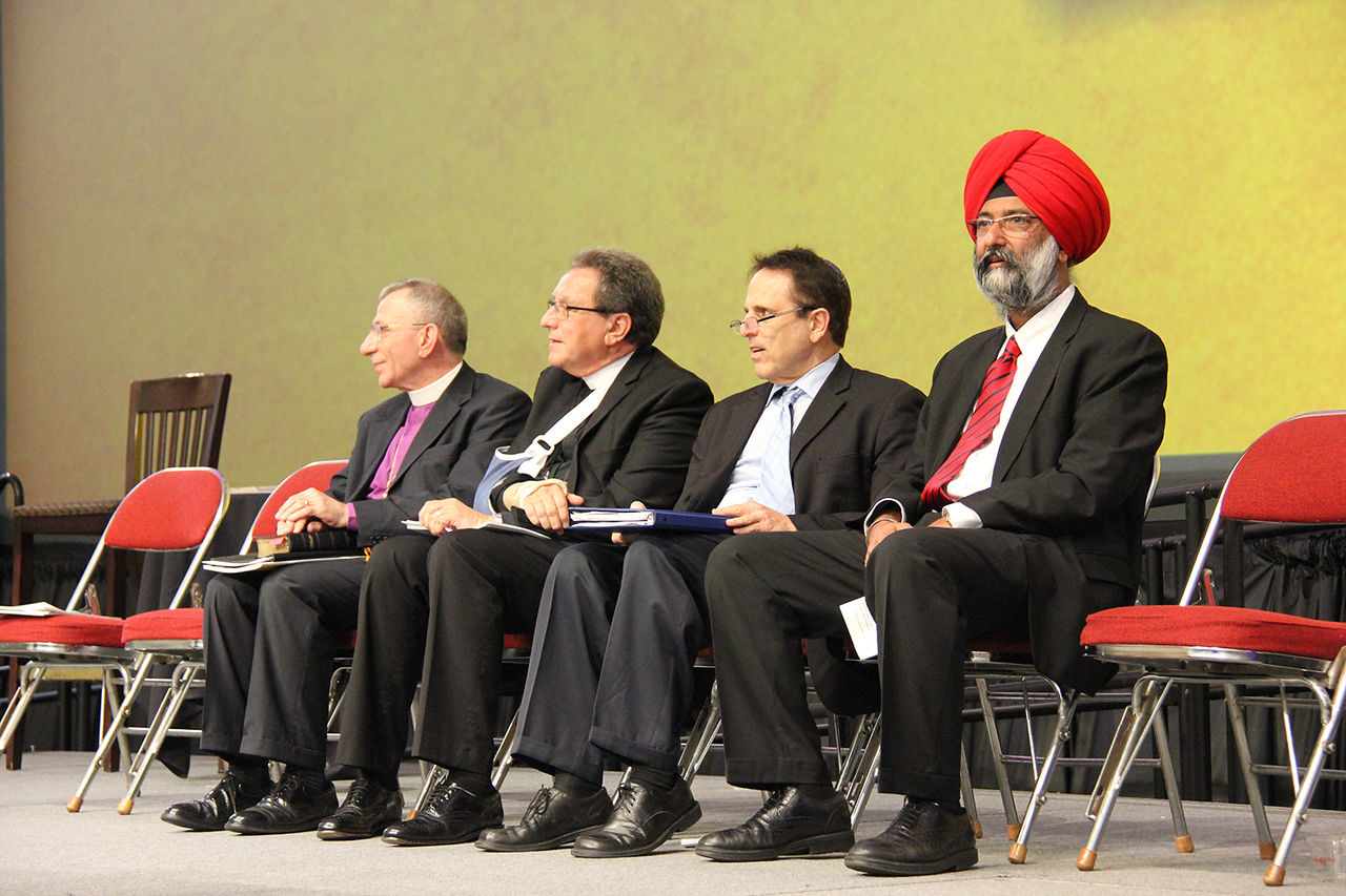 Bishop Munib Younan, the Rev. Donald McCoid, Rabbi Steve Gutow and Dr. Tarunjit Singh Butalia are on stage during the Assembly.