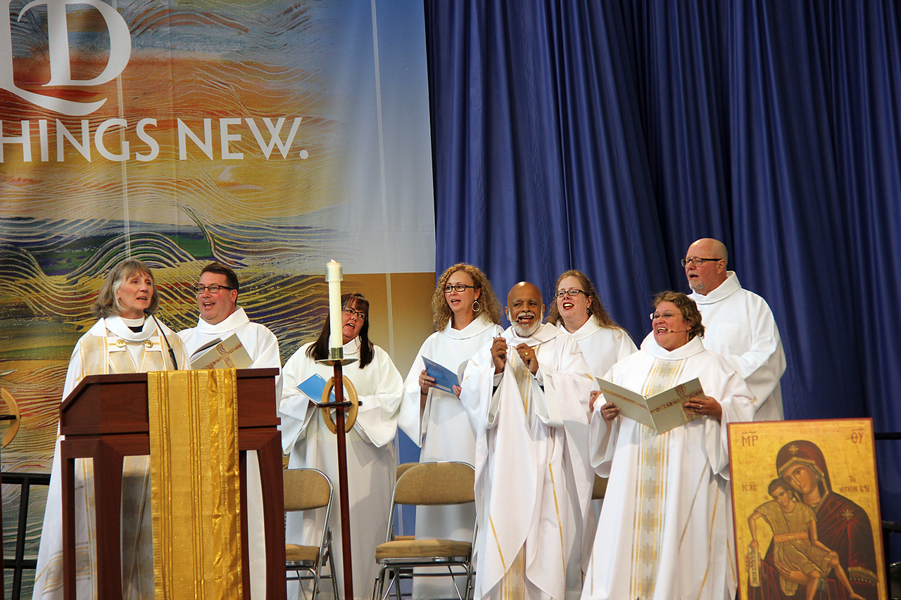 Worship leaders sing during the opening music.