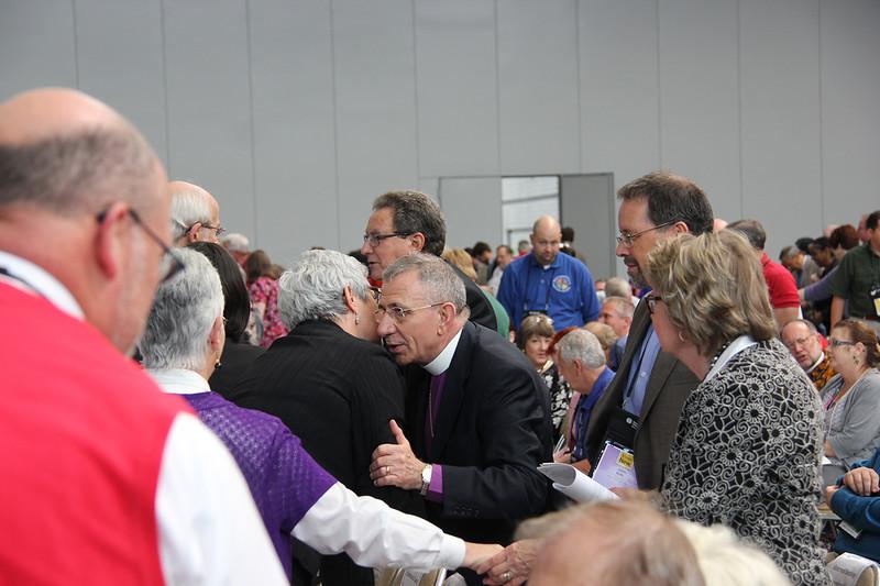 Bishop Munib Younan is greeted during worship on Thursday morning.