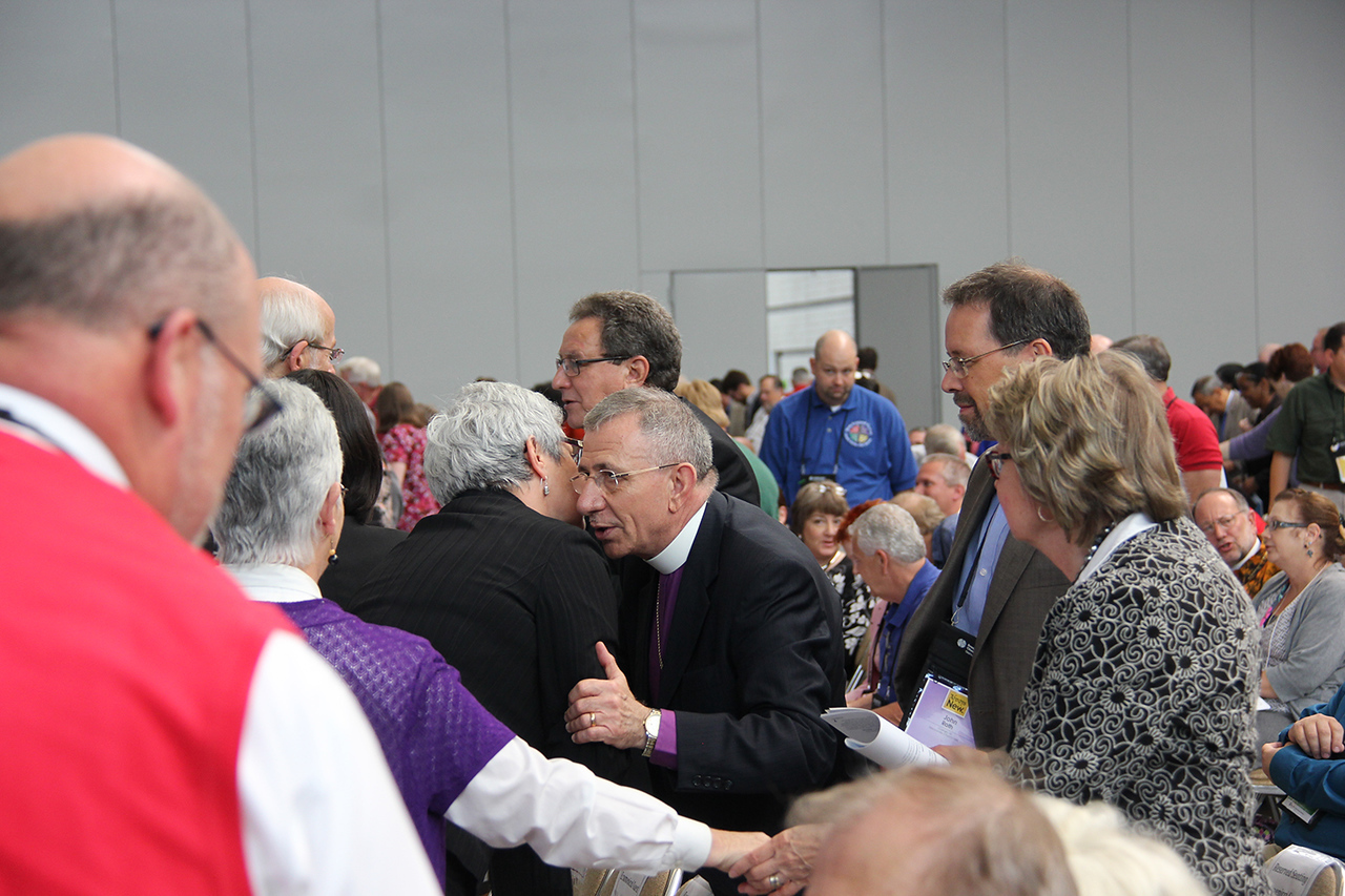 Bishop Munib Younan is greeted during worship on Thursday morning.