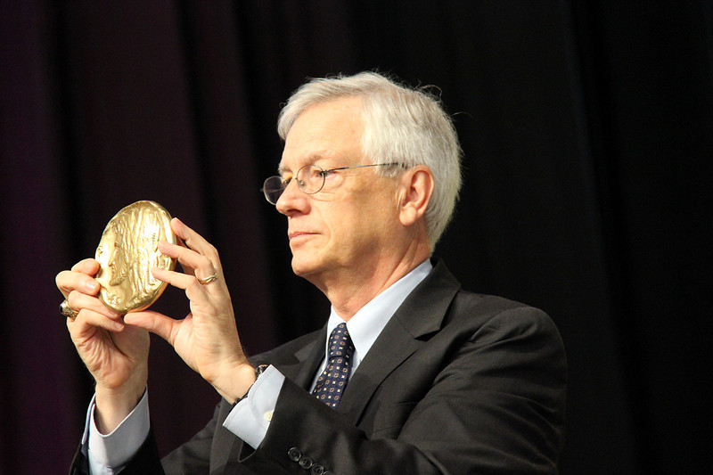 David Swartling, secretary of the ELCA, holds the Servus Dei Medal.