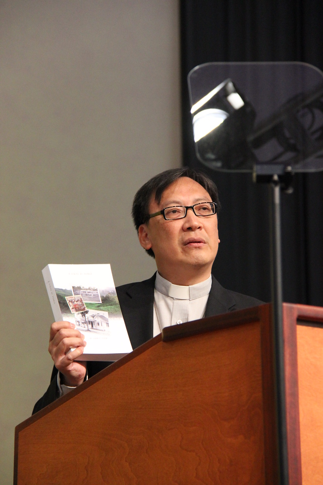 Bishop Philip Oi Peng Lok of the Lutheran Church in Malaysia and Singapore presents a gift to the ELCA.