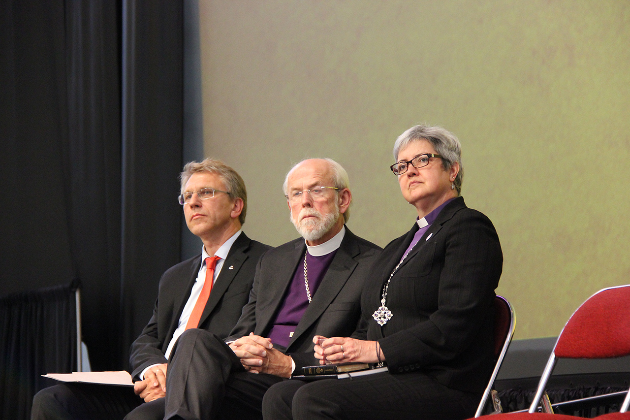 The Rev. Dr. Olav Fykse Tveit, general secretary of the World Council of Churches, Presiding Bishop Mark S. Hanson and Bishop Susan Johnson, the national bishop of the Evangelical Lutheran Church in Canada and the Lutheran World Federation Vice-President for North America, listen to the Most Reverend Katharine Jefferts Schori, presiding bishop of The Episcopal Church greet the Assembly.