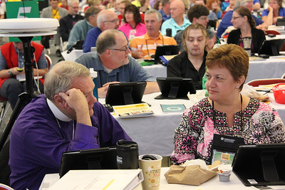 ELCA New Jersey Synod Bishop Riley and Bishop-elect Tracie L. Bartholomew in foreground, per instruction to the assembly from Presiding Bishop Mark Hanson, talk about one person whose witness has had a strong influence on their faith life and one person to whom they are now witnessing.