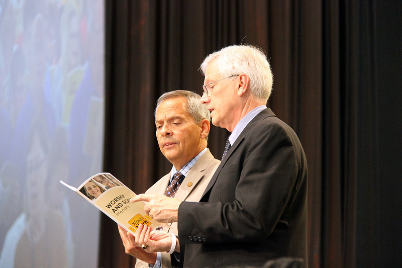 Carlos E. Peña, vice president of the ELCA, and David Swartling, secretary of the ELCA, on stage during the afternoon plenary.