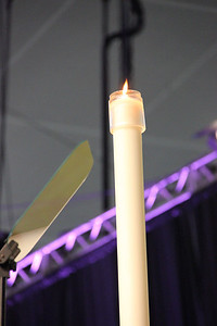 A candle burns at the Assembly.