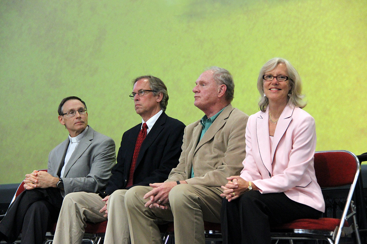 Cynthia Osbourne, chair of the task force for the ELCA social statement on criminal justice, is on stage with Roger Willer, ELCA director for theological ethics, David Frederickson, another member of the task force and Jack Munday, a member of Church Council and liaison to the task force.