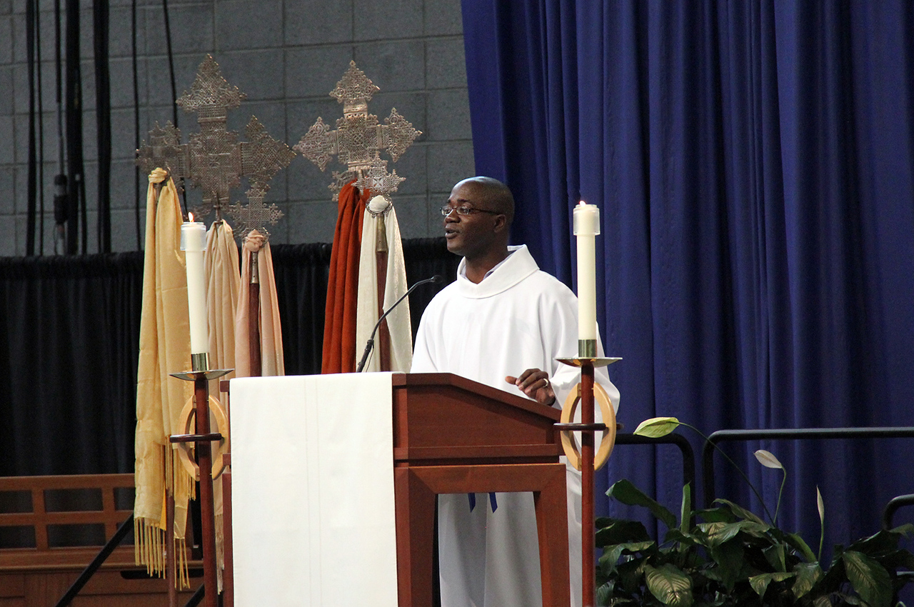 The Rev. Yeheil Curry shares the message in worship.
