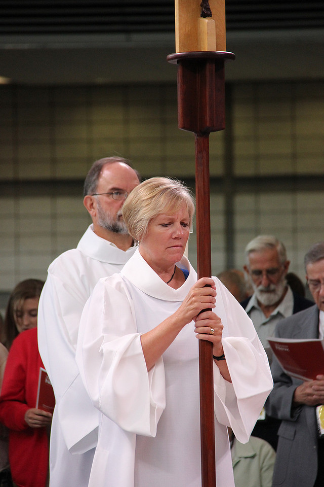 The processional cross is brought into the worship space.