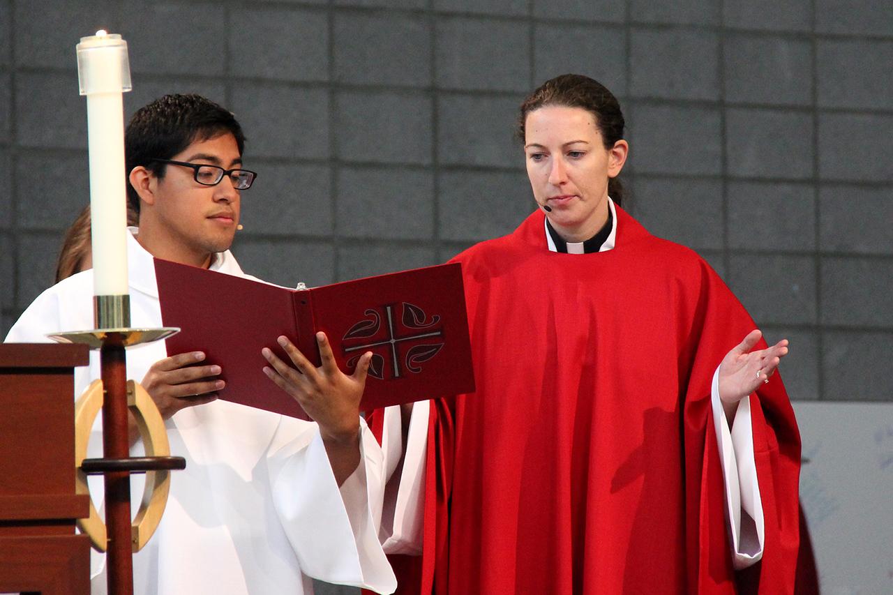 The Rev. Erin Evans and the Rev. David Rojas Martinez lead worship.