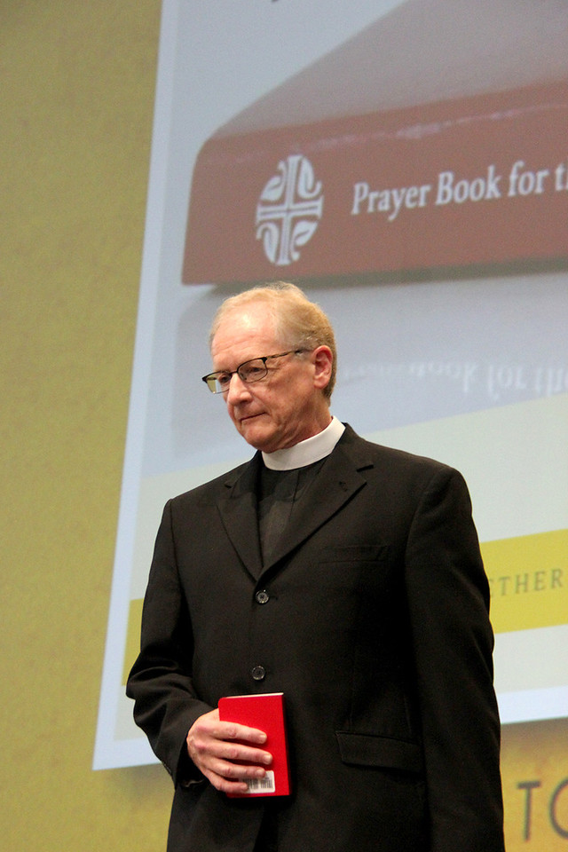 The Rev. Martin Seltz, publisher for worship at Augsburg Fortress, holds a copy of The Prayer Book for the Armed Services.