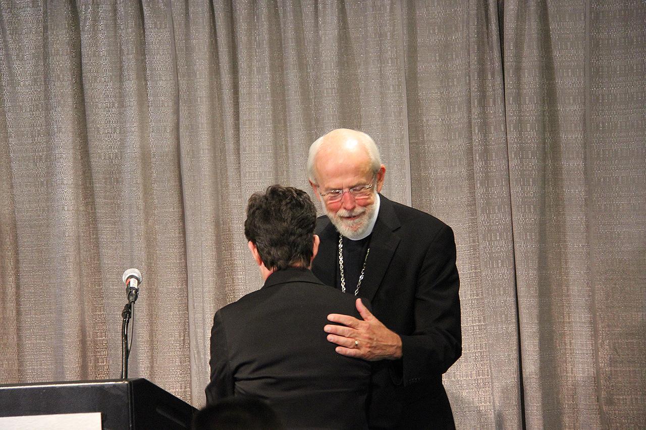 Presiding Bishop Mark S. Hanson greets the Rev. Elizabeth A. Eaton, presiding bishop-elect, at a news conference on Wednesday, Aug. 14.