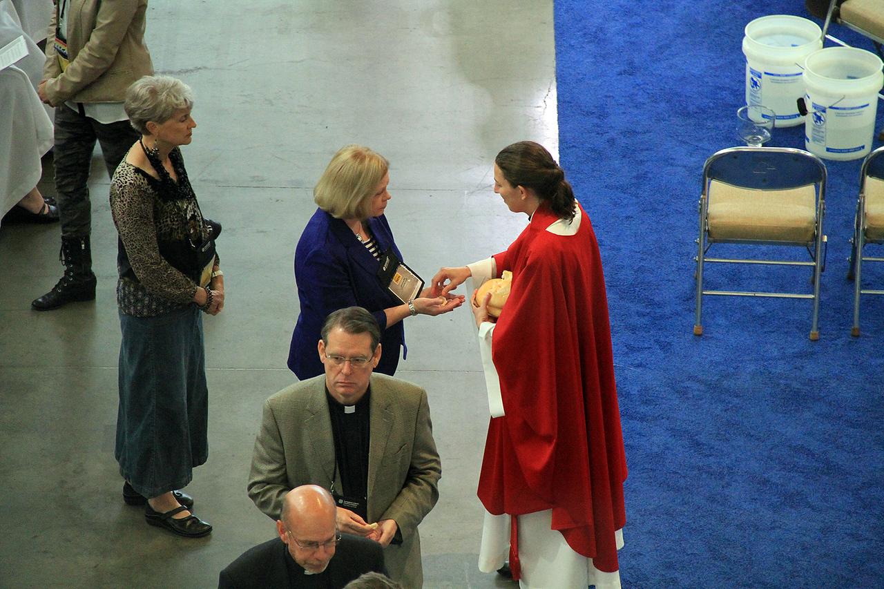 The Rev. Erin Evans serves communion.