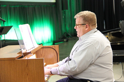 Scott Weidler accompanies the Assembly during a morning hymn.