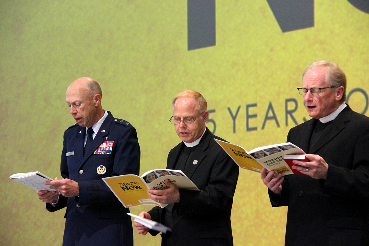 Chaplain, Major General Howard D. Stendahl, Chief of Chaplains for the United States Air Force, Pastor Eric Wester, assistant to the presiding bishop and director of Federal Chaplaincies and Pastor Martin Seltz, publisher for worship at Augsburg Fortress sing during Assembly.