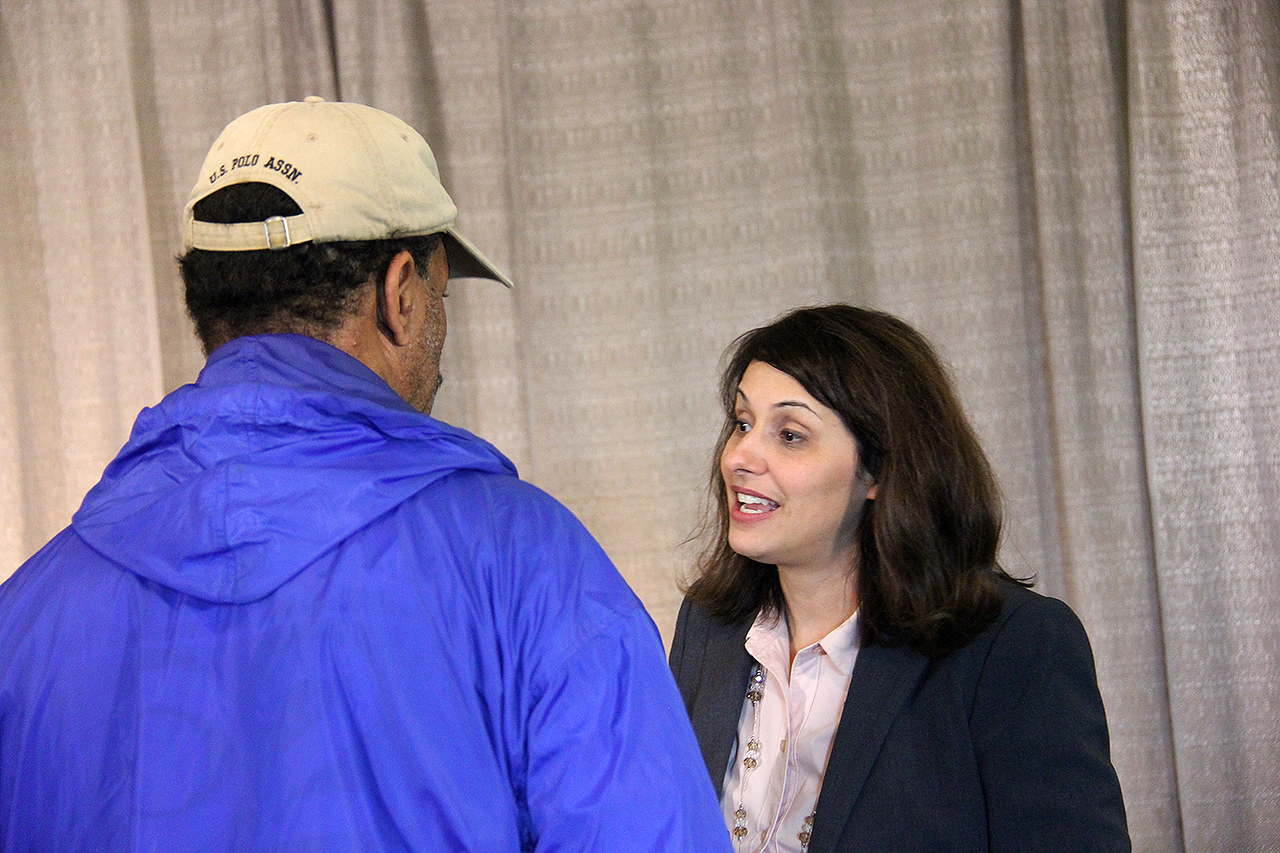 Melissa Ramirez-Cooper, public relations manager, speaks to a camera person at a news conference on Wednesday, Aug. 14.
