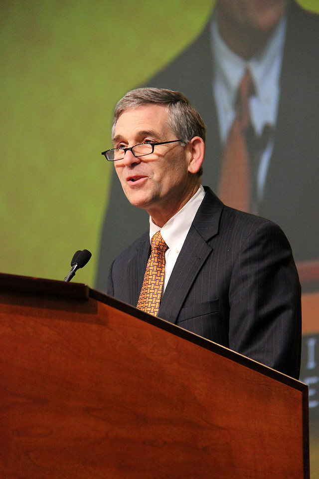 Dr. Darrel Colson, president of Wartburg College, presents the college's report.