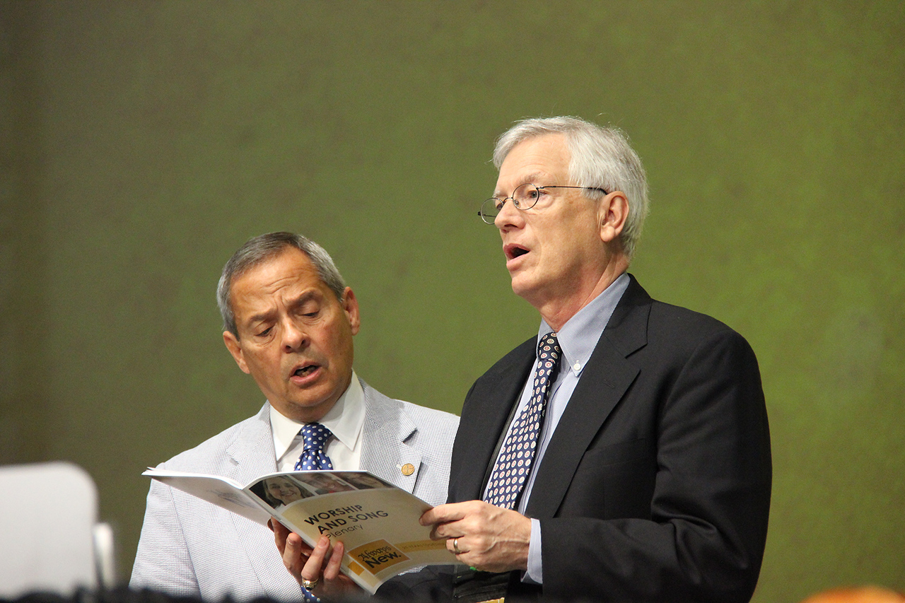 Carlos E. Peña, vice president of the ELCA, and David Swartling, secretary of the ELCA, sing during the morning plenary.