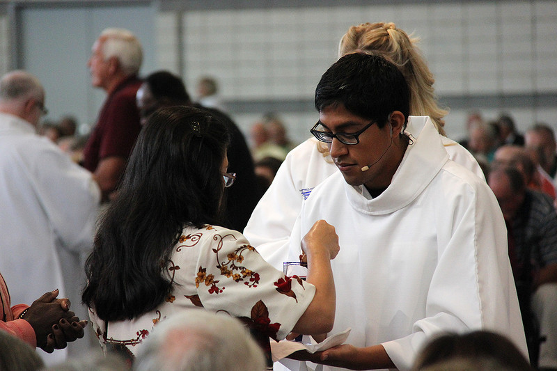 Holy Communion is shared during worship by the Rev. David Rojas Martinez.