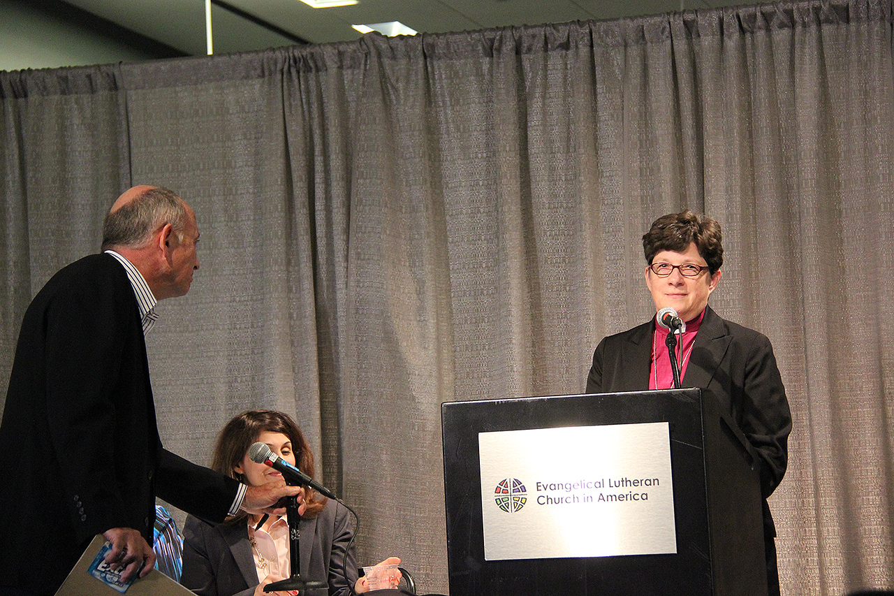 The Rev. Elizabeth A. Eaton, presiding bishop-elect, receives a question at a news conference on Wednesday, Aug. 14, from Dan Lehmann, editor of The Lutheran magazine.