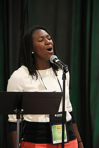 A singer  accompanies  the Assembly participants.