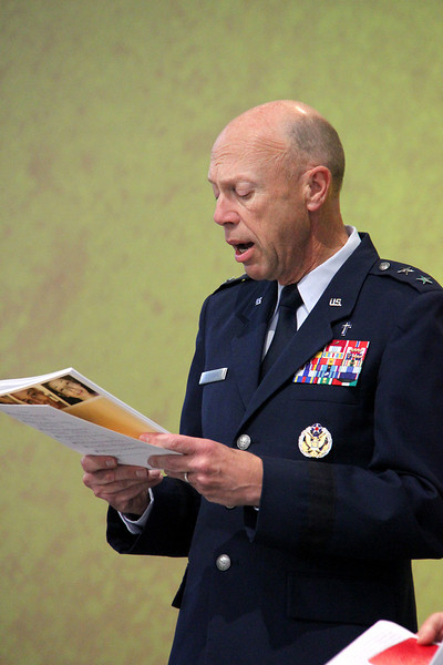 Chaplain, Major General Howard D. Stendahl, Chief of Chaplains for the United States Air Force sings during Assembly.