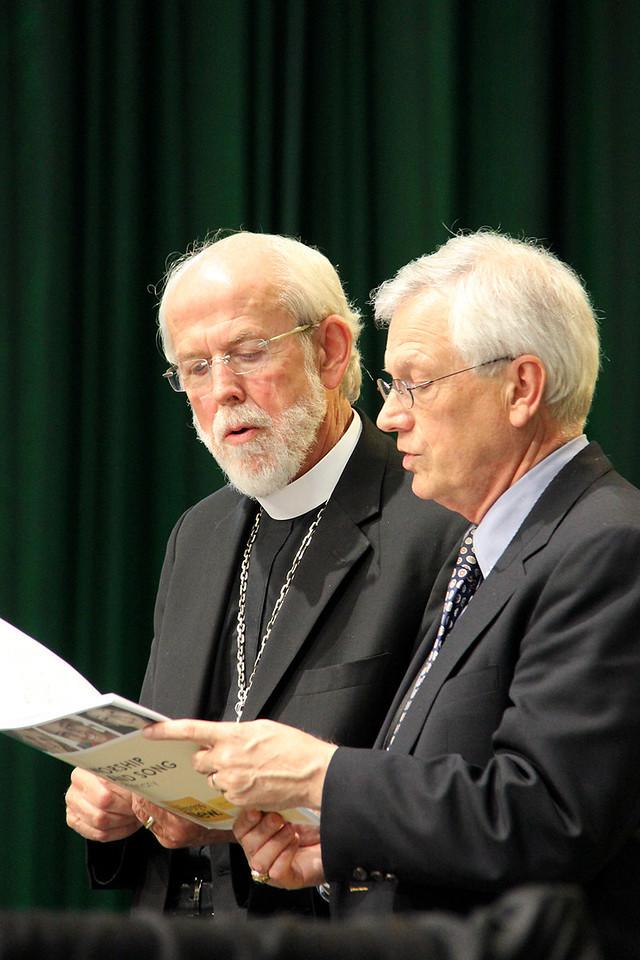 Presiding Bishop Mark Hanson and David Swartling, secretary of the ELCA, sing during Assembly.