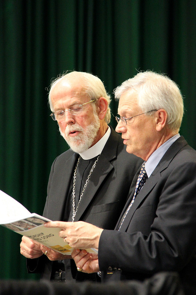 Presiding Bishop Mark Hanson and David Swartling, secretary of the ELCA, sing during Assembly.