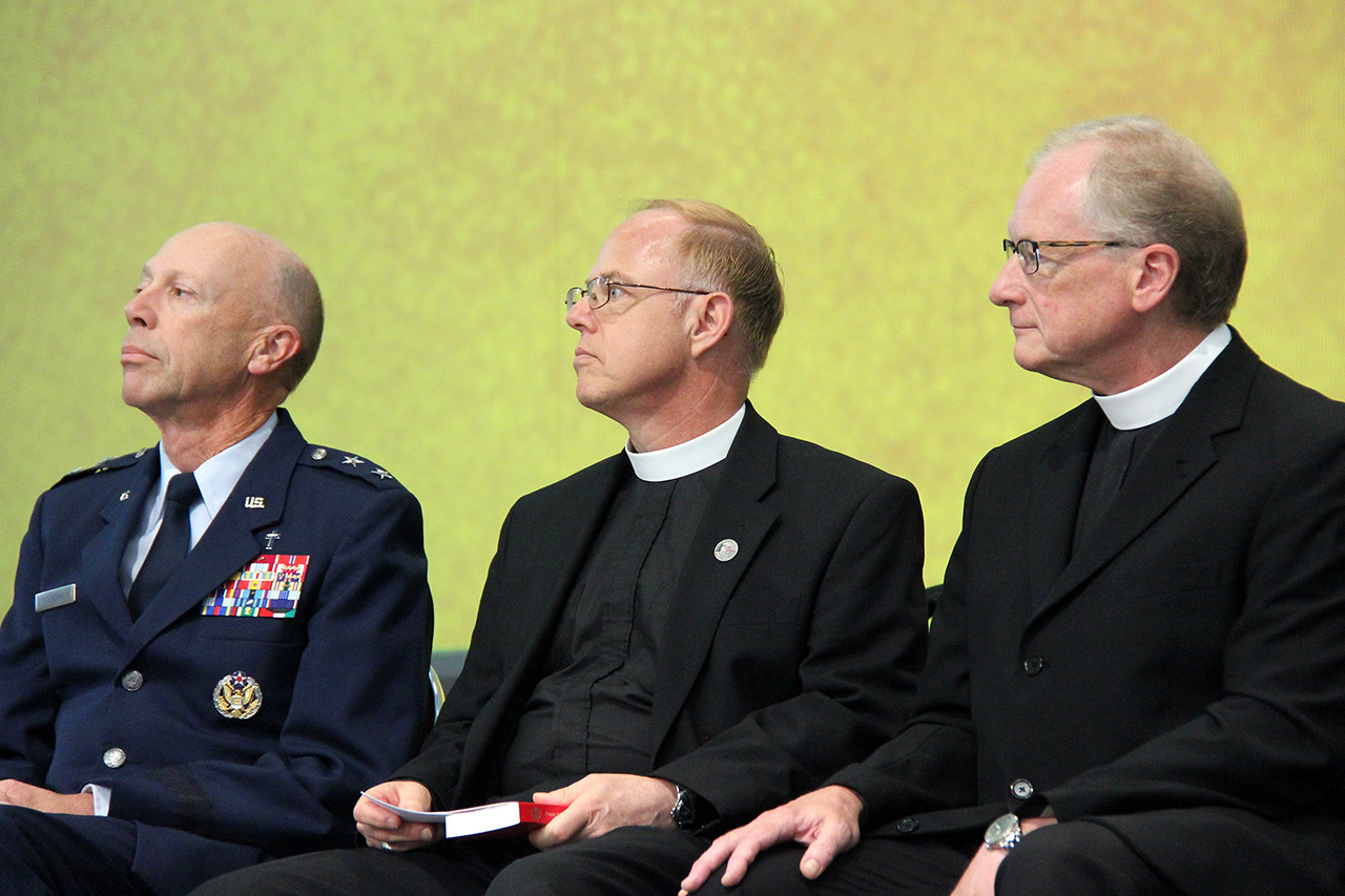 Chaplain, Major General Howard D. Stendahl, Chief of Chaplains for the United States Air Force, Pastor Eric Wester, assistant to the presiding bishop and director of Federal Chaplaincies and Pastor Martin Seltz, publisher for worship at Augsburg Fortress listen as information is shared about The Prayer Book for the Armed Services.