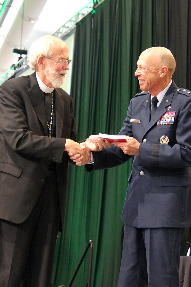 Presiding Bishop Mark Hanson presents a copy of the Evangelical Lutheran Worship Prayer Book for the Armed Services to Chaplain, Major General Howard D. Stendahl, Chief of Chaplains for the United States Air Force.