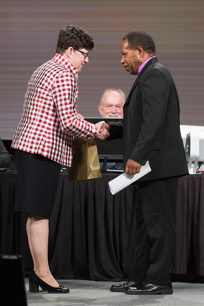081216 - New Orleans, LA - The 2016 Churchwide Assembly Plenary Session Eight. William Horne elected new vice president. Pictured is Bp. Eaton presenting a gift to the Rev. Dr. Jack Urame, bishop of the Evangelical Lutheran Church of Papua New Guinea.
