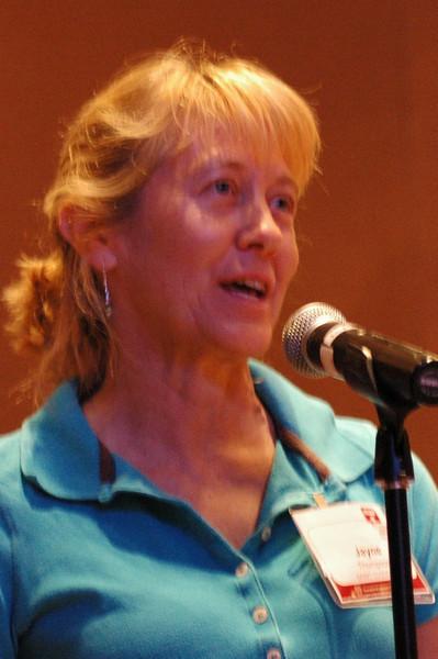 Joyce Thompson asks a question of Bishop Hanson