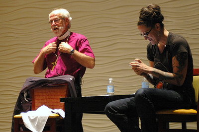 Presiding Bishop Mark S. Hanson prepares to don the t-shirt given to him by the Rev. Nadia Bolz-Weber