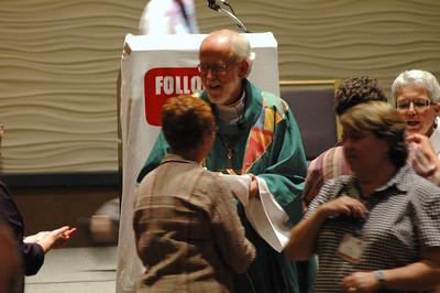 Presiding Bishop Mark S. Hanson during Communion