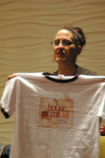 The Rev. Nadia Bolz-Weber displays her congregation's t-shirt