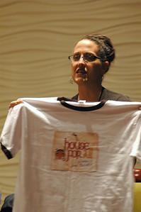 The Rev. Nadia Bolz-Weber displays her congregation's t-shirt
