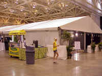 """The ELCA churchwide organization was represented at """"The Beat"""" with a large tent at the America's center.  In it, participants made """"masks"""" of their faces and played """"Who Wants to Be a   Missionaire."""""""
