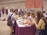 """""""The Beat"""" was an interactive display area at the America's Center.   Here, a group of Youth Gathering participants make a memento at one of the display tables."""