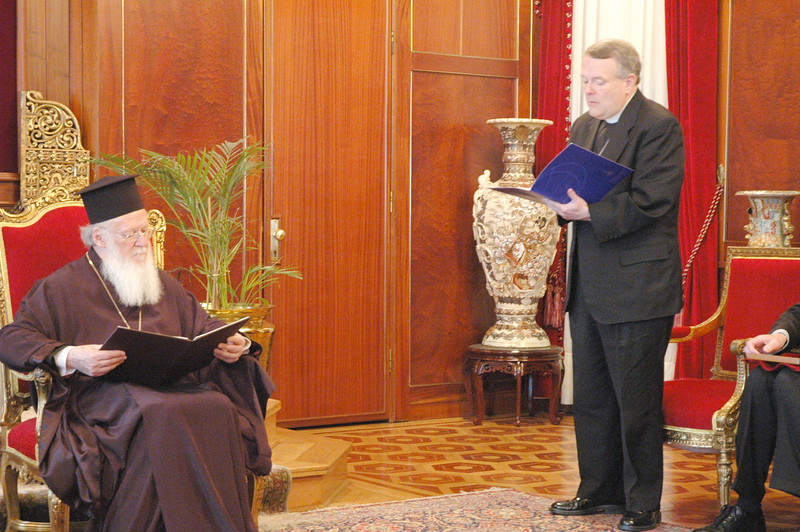 The Rev. E. Roy Riley Jr., standing, bishop of the ELCA New Jersey Synod and chair of the ELCA Conference of Bishops, reads a formal greeting from the ELCA to His All Holiness Ecumenical Patriarch Bartholomew, seated, during a March 17 meeting in Istanbul.