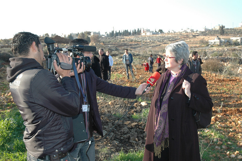ELCIC National Bishop Susan Johnson speaks to a Wattan Television (Ramallah) crew Jan. 12 in Beddo, West Bank, while the bishops planted olive trees.