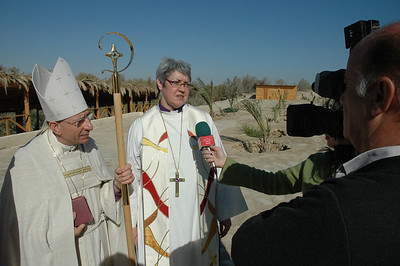 ELCIC National Bishop Susan Johnson speaks to Jordanian Television at the site of Jesus' Baptism in Jordan Jan. 6.  At her right is ELCJHL Bishop Munib Younan.