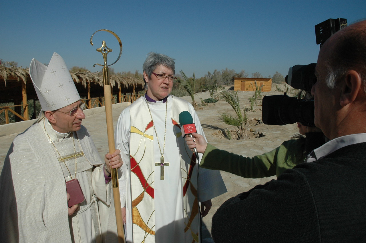 ELCIC National Bishop Susan Johnson speaks to Jordanian Television at the site of Jesus' Baptism in Jordan Jan. 6.  At her right is ELCJHL Bishop Munib Younan.