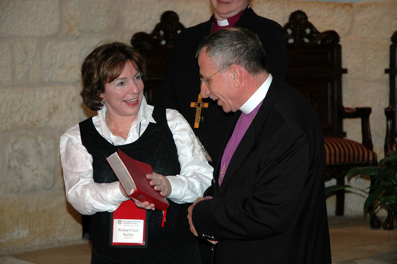 Bishop Claire Burkat, ELCA Southeastern Pennsylvania Synod, presents a copy of Evangelical Lutheran Worship, signed by bishops who attended the 2009 Bishops' Academy Jan. 6-13, to ELCJHL Bishop Munib Younan.