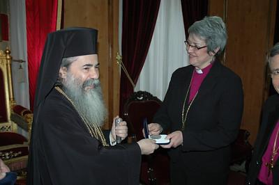 Beatitude Theofilos III, Greek Orthodox Patriarch of Jerusalem, presents a gift to ELCIC National Bishop Susan Johnson Jan. 9 in Jerusalem.