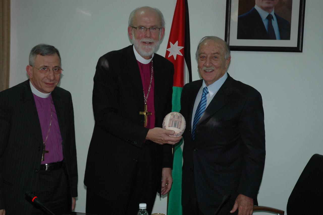 ELCA Presiding Bishop Mark Hanson, center, accepts a gift from Zeid Al Rafai, president of the Jordanian Senate, in Amman Jan. 4.  At left is Bishop Munib Younan of the ELCJHL.