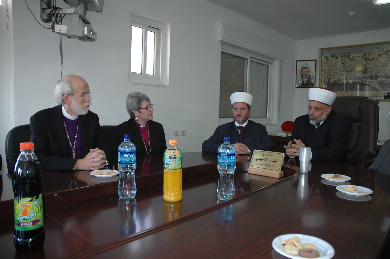 Sheik Al-Tamini, right, supreme judge of the Islamic courts, Palestine, addresses ELCA Presiding Bishop Mark Hanson, left, and ELCIC National Bishop Susan Johnson at a Jan. 13 meeting in Ramallah.